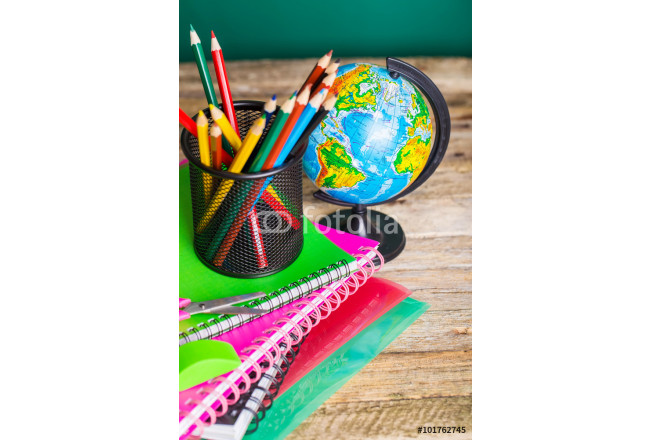 School supplies on the background of the school board 64239