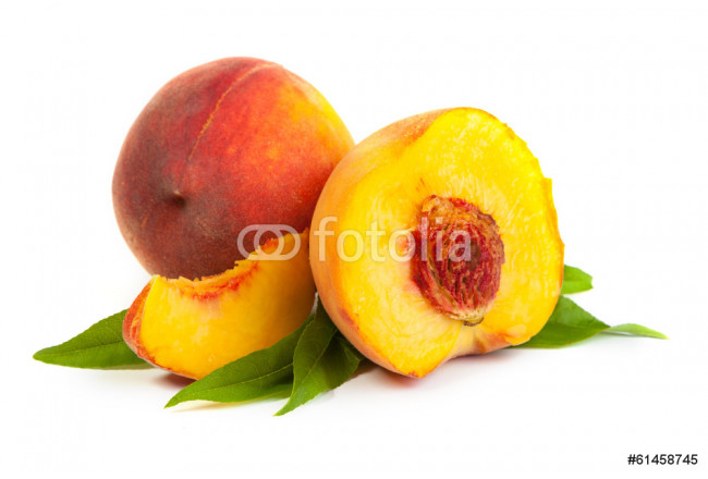 Three perfect, ripe peaches with a half  and slices isolated on 64239