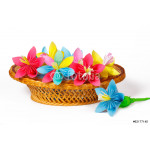 Colored paper flowers in the basket and one flower near it 64239