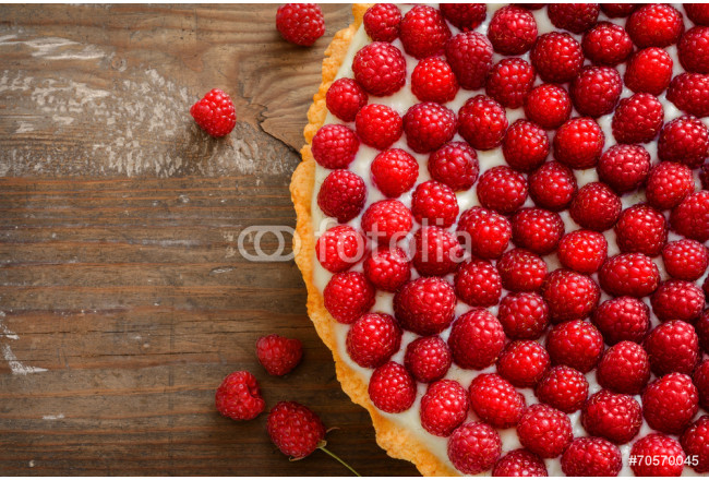 Delicious raspberry tarts on a wooden board 64239