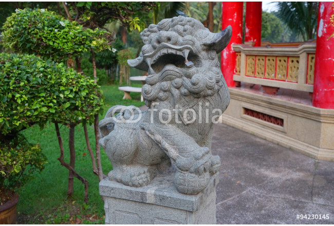 stone lion in the park 64239