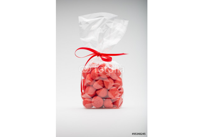Luxury bag of acidulous strawberries isolated with elegant red r 64239