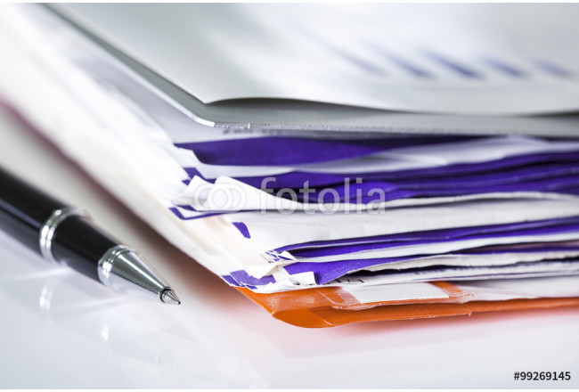 Stack of bills and pen 64239