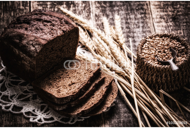 Fresh bread on wooden table ,vintage filter 64239