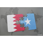 puzzle with the national flag of bahrain and somalia on a world map background. 64239