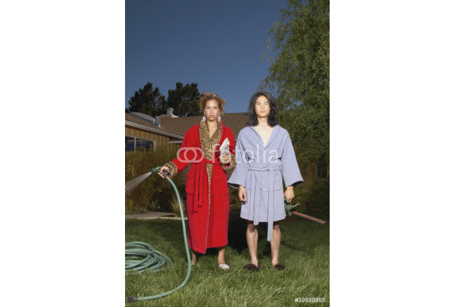 Couple in robes watering yard 64239