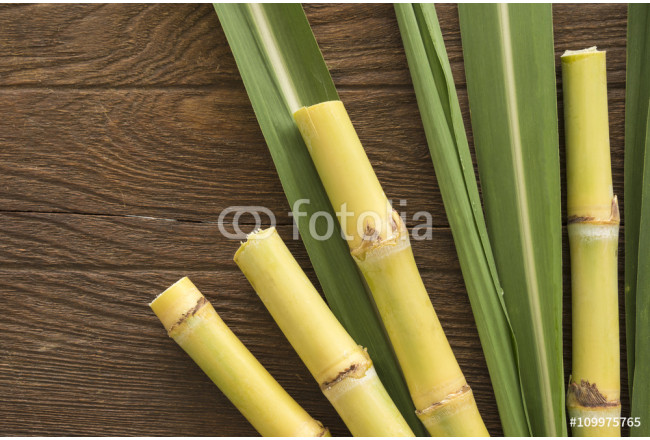 sugarcane cut into pieces on a wooden table 64239