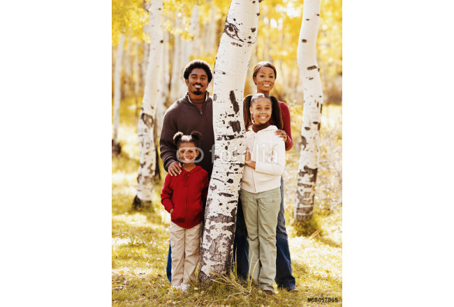 African family standing next to tree 64239