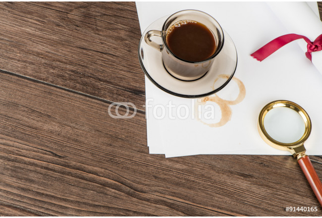 Coffee cup, paper sheets and detective hat 64239