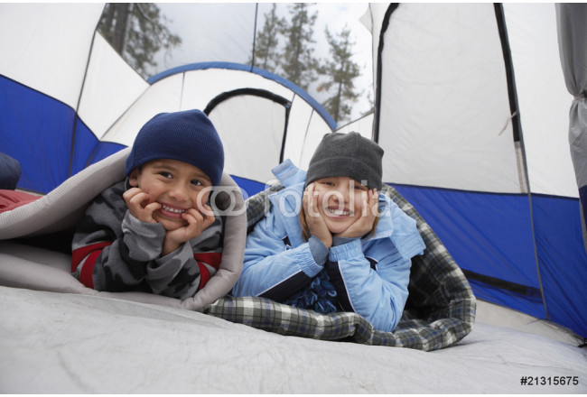 brother and sister (7-12) in tent (portrait) 64239