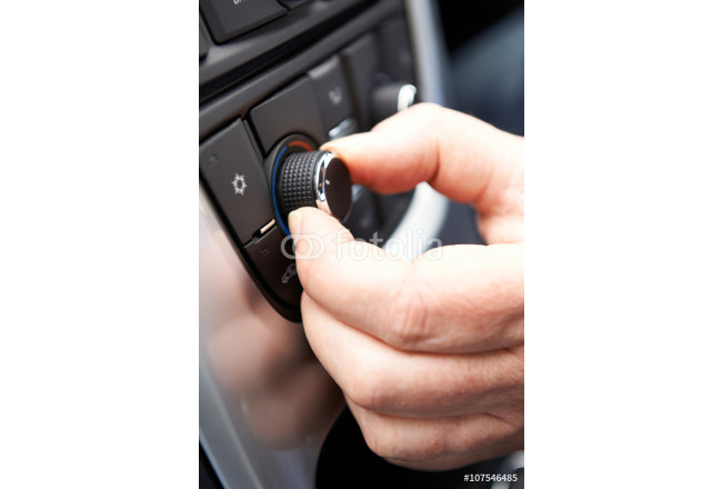 Close Up Of Hand Adjusting Car Air Conditioning Control On Dashb 64239