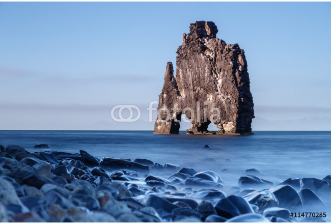 Hvitserkur, giant rock with the shape of a dinosaur at Hunafjoraur, taken at the blue hour with a long exposure time