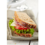 fresh deli sandwich with tomatoes, swiss chees, lettuce 64239