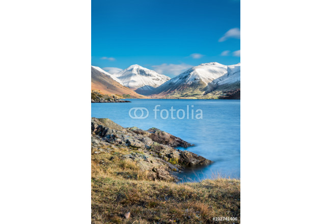 Layer of snow on mountain peaks at Wast Water Lake in the English Lake District on a beautiful sunny day. 64239