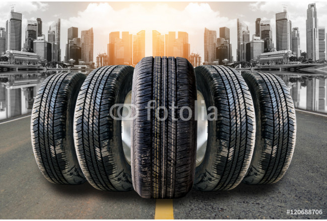 Car tires in row on the street with the skyscrapers background. 64239