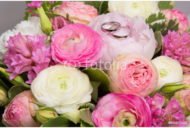 wedding rings on bouquet of white and pink peonies 64239