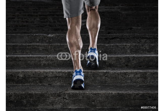 Close up of young man running up the stairs 64239