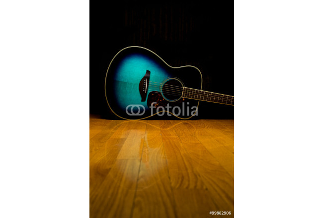 Guitar on hardwood 64239