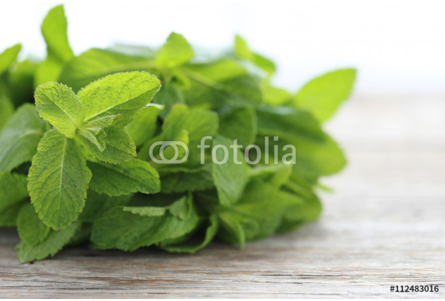 Fresh mint leafs on grey wooden table 64239