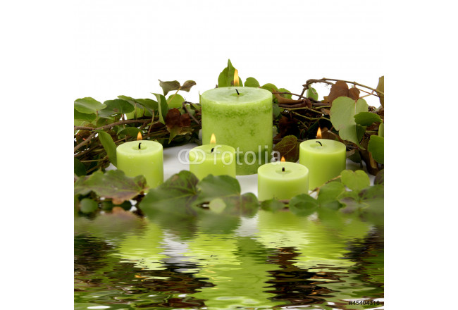Reflection of burning candle with circle green leaves 64239