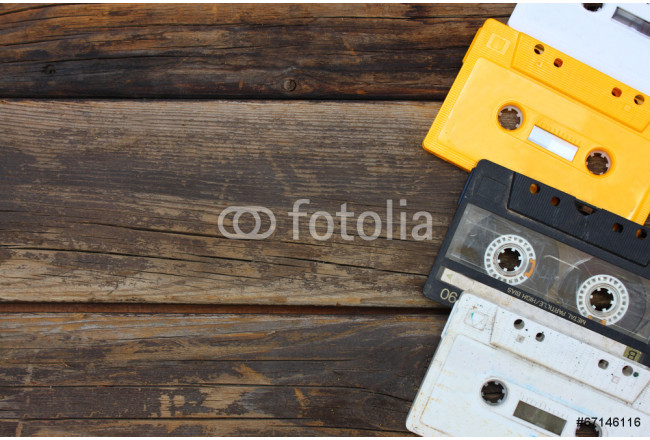 Bild auf Leinwand Cassette tapes over wooden table. top view.   64239