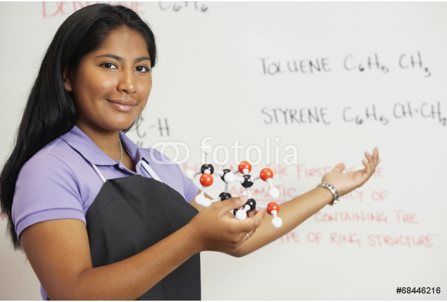 Hispanic teenaged girl in science class 64239