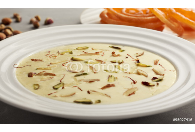 Cuadro decorativo Delicious Indian sweet Rabdi made of condensed milk topped with almonds, pistachio and saffron which is accompanied with hot Jalebi. 64239