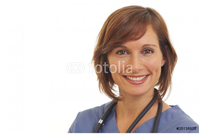 Close up portrait of smiling young woman doctor in scrubs 64239