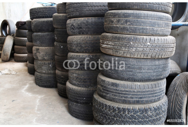 Old tires stacked. 64239