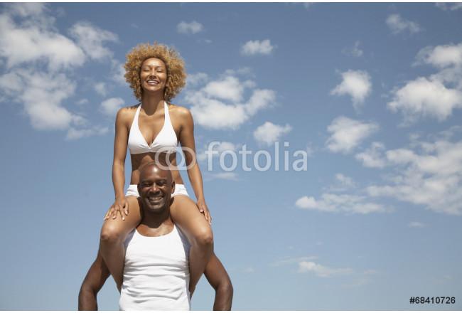 African man carrying wife on shoulders 64239