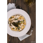 Italian pasta with chicken, cream sauce and basil over grunge wooden table. Delicious dinner concept. Top view. Space for text 64239