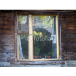 Window of country house. Wooden house, window, indoor plants, curtains, trees reflected in the glass. View oknnoy frame from the street 64239