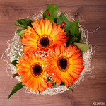 Bouquet of orange gerberas with small white blooms 64239