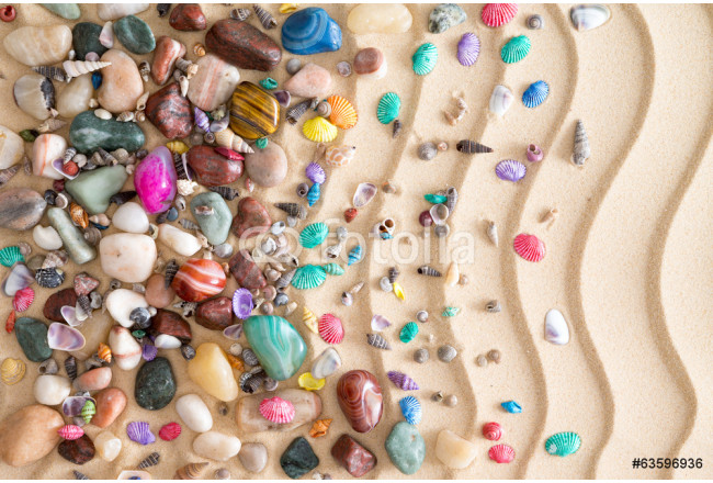 Pebbles, gemstones and shells on beach sand 64239
