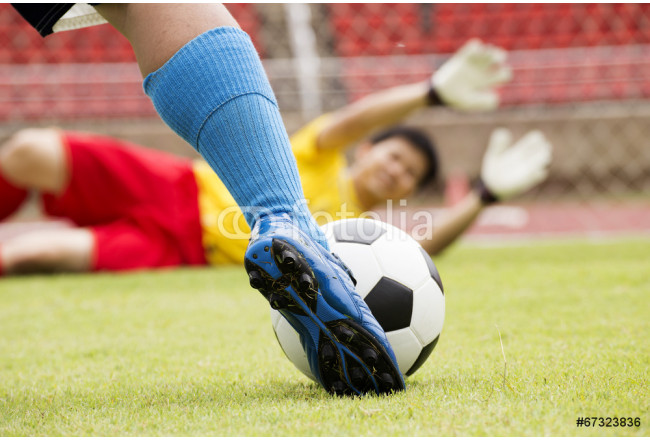 soccer player with ball before shooting 64239