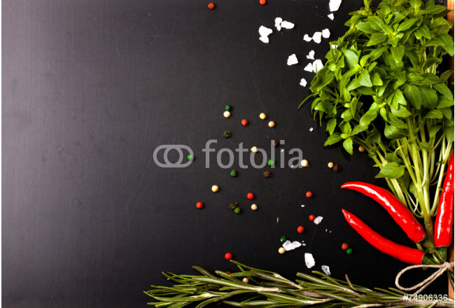 Herbs and spices. basil, red pepper, salt and rosemary on a blac 64239