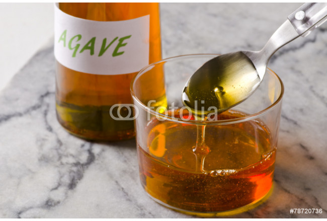 Agave syrup pouring on a glass. 64239