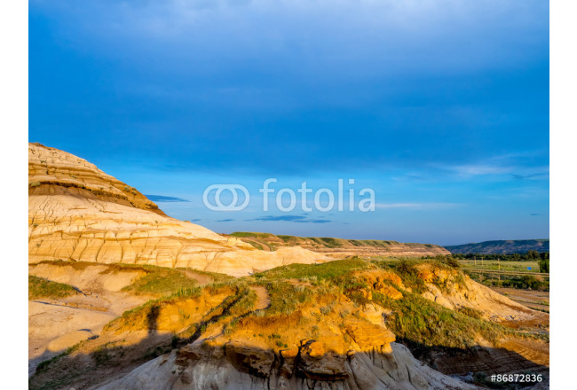 Badlands bathed in the warm light of a summer sunset near drumheller in Alberta Canada. 64239