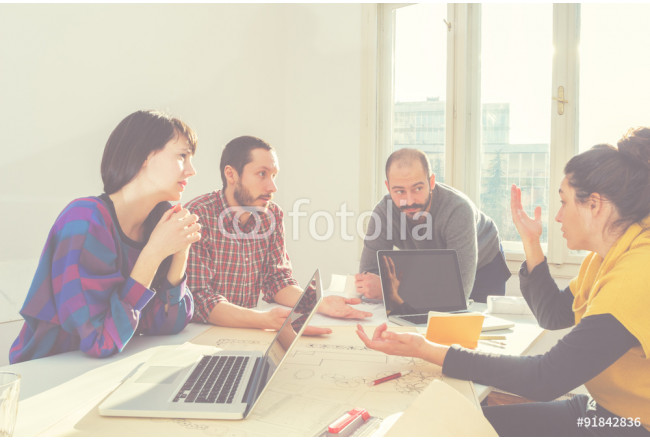 Young group of people/architects discussing business plans. 64239