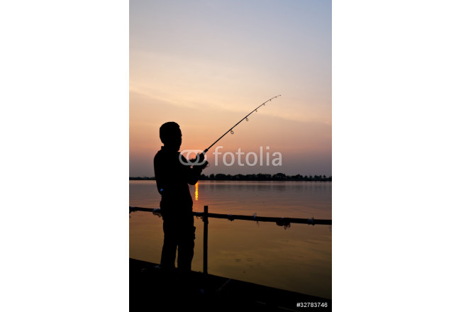 Silhouette of a man fishing 64239