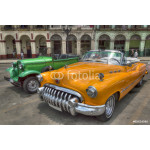 Orange and green cars in front of Capitolio, Havana, Cuba 64239