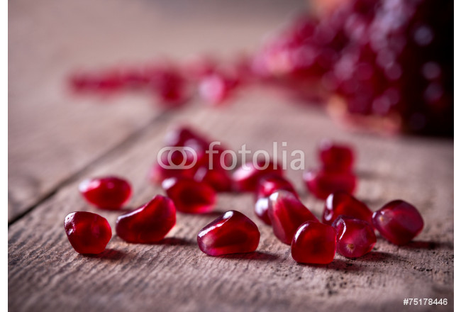 Red pomegranate seeds on old wooden table 64239