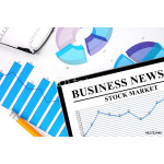 Tablet with  business news of stock market and graphs. 64239