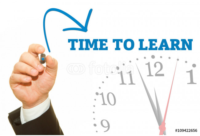 Businessman hand writing TIME TO LEARN message on a transparent wipe board. 64239