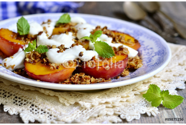Grilled peachs with granola and whipped cream. 64239