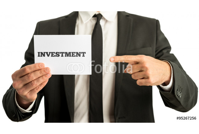 Financial adviser holding up a white card with Investment sign 64239