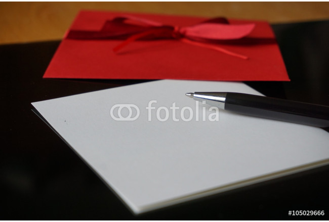 Black pen writing announcement letter with the decorated red envelope 64239