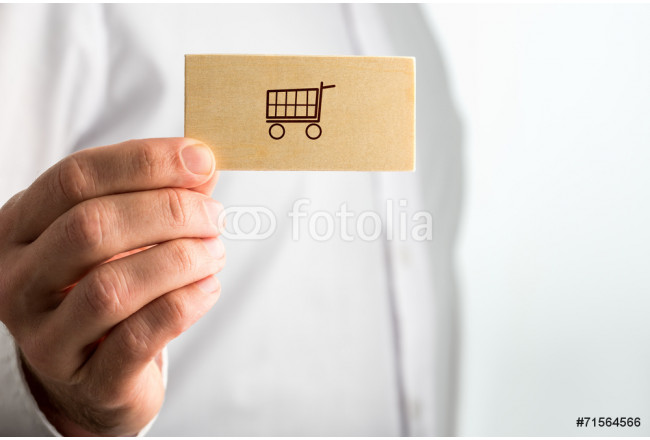 Man holding a business card with a shopping icon 64239