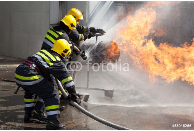 Firefighters attack a propane fire during a training exercise 64239