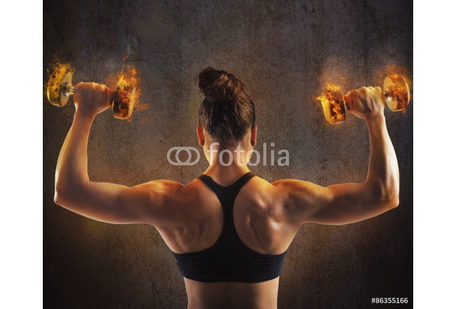 Woman training with  fiery dumbbells 64239